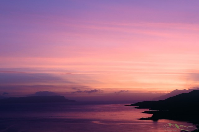 The calm waters of the Sound of Sleat reflect the tranquility of the sunset with only the gentle lapping of water on the foreshore to break the silence